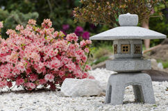 stone lantern with an azalea in full bloom Royalty Free Stock Photography