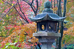Stone lantern and fall foliage Stock Photography