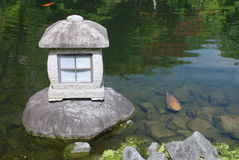 Stone Lantern and Fish Stock Photo