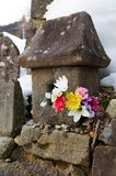 Stone Lantern and Flowers. A Stone Lantern and Some Flowers by the Side of the Road in Yudanaka royalty free stock photo