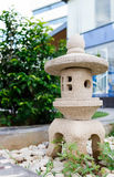 A stone Lantern in garden Stock Photos