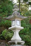 A stone lantern at Itsukushima Shrine in Hiroshima, Japan Stock Image