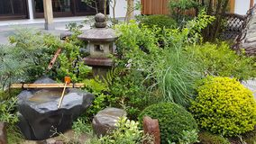 Stone lantern. In the Japanese garden Stock Image