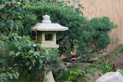 Stone lantern made of granite in an Asian garden Royalty Free Stock Photo