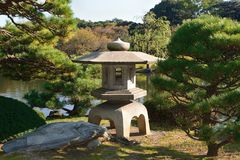 Stone lantern and pine Royalty Free Stock Photography