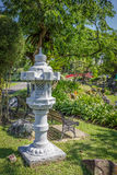 Stone lantern sculpture in garden Stock Photography