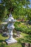 Stone lantern sculpture in garden Stock Photography