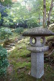 Stone lantern. With the trail royalty free stock photography
