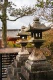 Stone Lanterns at Kiyomizu-dera Temple, in Kyoto, Japan. Stone Lanterns on an autumn background at the famous Kiyomizu-dera Buddhist Temple, in Gion District royalty free stock photography