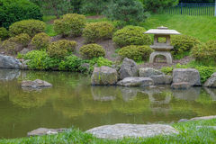 Stone lanterns and rocky paths surrounding the Koi Pond at the s Stock Photos
