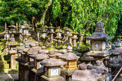 Stone lanterns at Tamukeyama Hachimangu Shrine in Nara Stock Photo