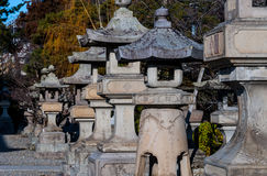 Stone lanterns at Zenko-ji temple. Nagano, Japan - March 06, 2015: A line of stone lanterns at the historic Buddhist Zenko-ji temple Royalty Free Stock Photos