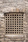 Stone lattice window wall of an ancient building Royalty Free Stock Photo