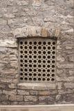 Stone lattice window wall of an ancient building Stock Photos