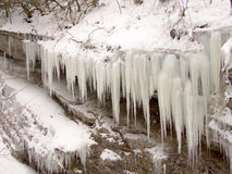 On a stone ledge hanging icicles Royalty Free Stock Photography