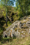 Stone ledge on the wooded hills Royalty Free Stock Photography