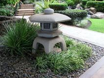 Stone lantern in the garden stock photo
