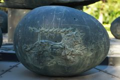 The stone of LEO. A concrete sculptured in egg shaped with a low relief lion mark on the surface, creating the LEO zodiac rock royalty free stock images