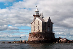 Stone Lighthouse Protects Mariners Stock Image
