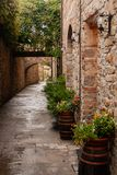 Stone-lined path in the old town of San Donato, Italy. royalty free stock image