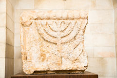 Stone Lintels decorated with Menorah. Stone Lintels decorated with seven-branched Menorah candelabrum.That is one of the oldest symbols of the Jewish people Royalty Free Stock Images
