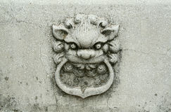 Stone lion. A relief. China. Nanjing Royalty Free Stock Photos
