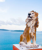 Stone lion ancient statue in sea . Royalty Free Stock Photo