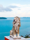 Stone lion ancient statue in sea . Stock Photography