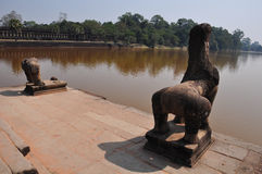 Stone lion and baray at Ankor Wat,Cambodia Stock Photography