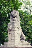 Stone lion with a board in paws Royalty Free Stock Image