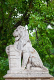 Stone lion with a board Royalty Free Stock Photo