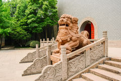 Stone lion before Chinese old-fashioned castle in sunny summer Royalty Free Stock Photography