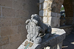 Stone lion with emblem. The exterior decoration of the Roman Catholic Church of Our Lady of the Rocks, artifisial island, coast of Perast in Bay of Kotor Royalty Free Stock Photo