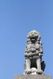 Stone lion at the entrance of an old villa Royalty Free Stock Image