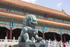 Stone lion in front of the Forbidden City royalty free stock photos