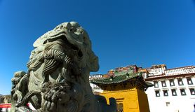 The stone lion in front of the Potala Palace Royalty Free Stock Photography