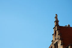 Stone Lion on a Gable Rooftop Stock Photography