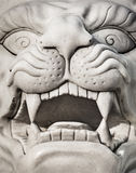 Stone lion head - marble statue. Stone lion head - a marble statue close-up Stock Photo