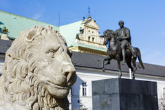 Stone lion head and statue of Jozef Poniatowski Stock Photos