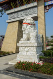 Stone lion at memorial gateway on sunny day Stock Photo