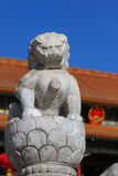 Stone Lion And national emblem. A lion stone looks like guarding the national emblem Royalty Free Stock Images
