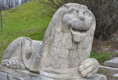 Stone lion in Olesko castle park Stock Photo