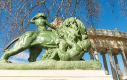 Stone lion. It is part of Monument to King Alfonso XII, located Royalty Free Stock Image