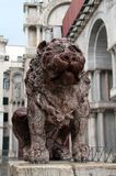 Stone lion in Piazza San Marco Royalty Free Stock Images