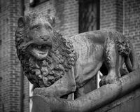 Stone lion. Sculpture of a lion before the castle Ter Haar, Utrecht, Netherlands stock images