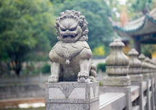 Stone lion sculpture on the fence Royalty Free Stock Image