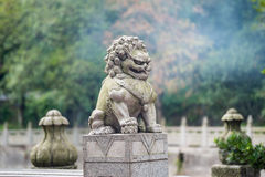 Stone lion sculpture on the fence Royalty Free Stock Photos