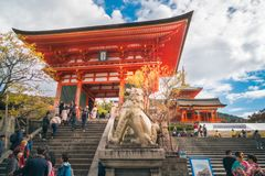 Stone lion sculpture in front of the entry to Kiyomizu-dera Temple, Kyoto, Japan. Kyoto, Japan -November 2, 2018: Stone lion sculpture in front of the entry to stock image