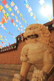 Stone Lion sculpture and the sun, symbol of protection power Stock Images