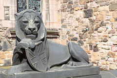 Stone lion sculpture with union jack shield Stock Images